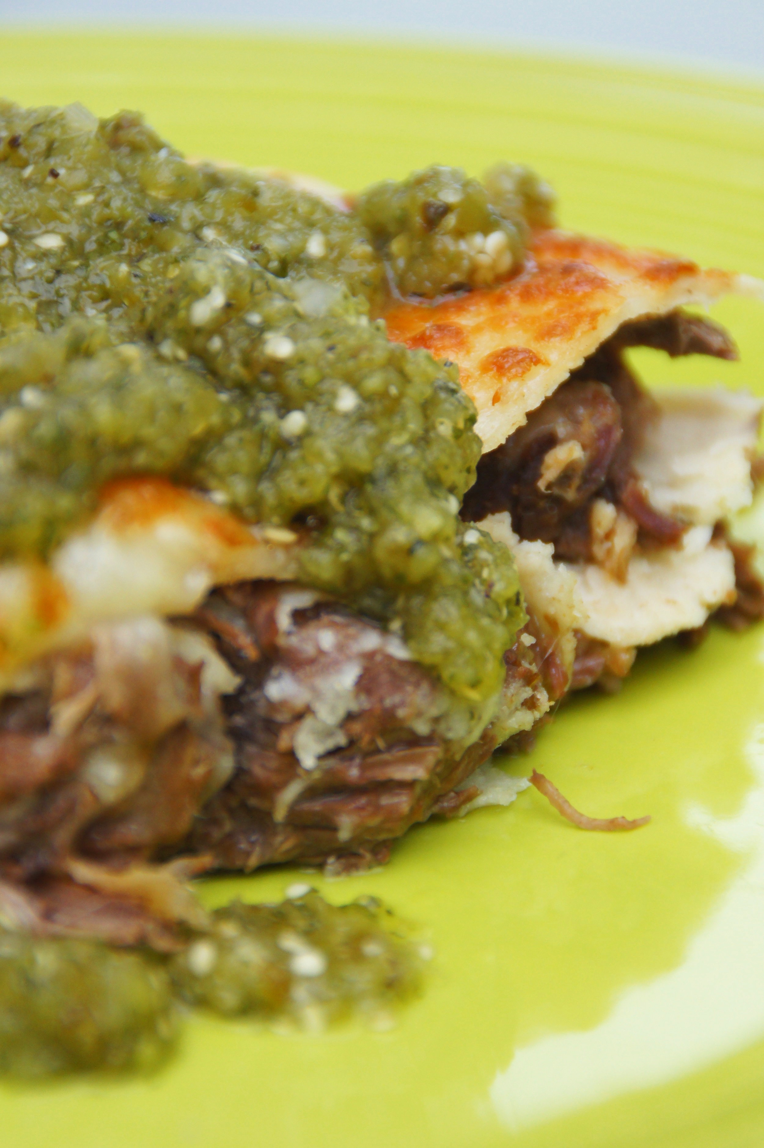Perfectly melted cheese topped with  fresh salsa verde .