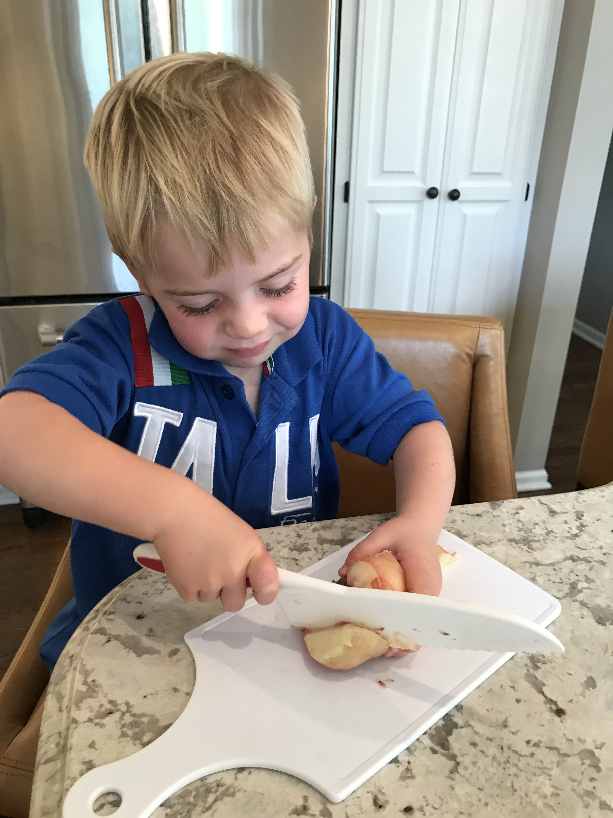 Being in the kitchen has become second nature for Will - he grabbed this nectarine off the counter, found his kids cutting board and knife and started cutting the nectarine so he could have a snack!!