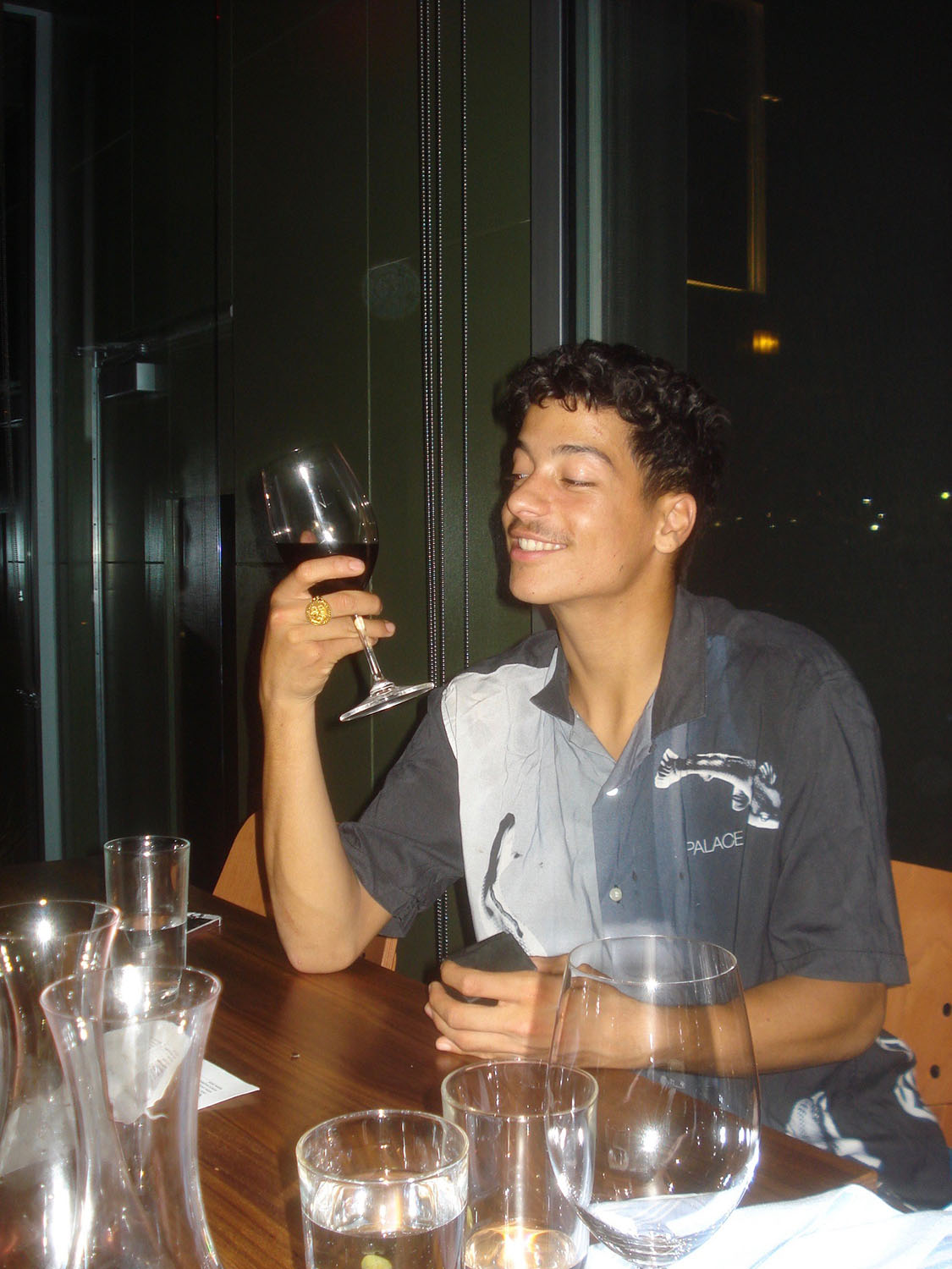 Heitor da Silva on his first Palace trip and embracing the lavish Palace lifestyle with an expensive glass of wine and admiring his new Palace ring. October 2018