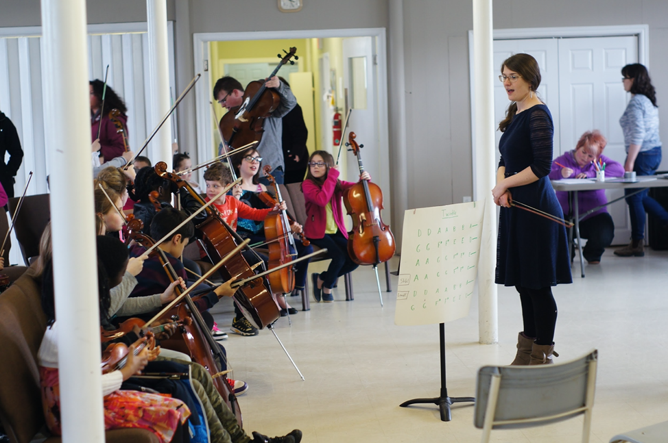 Carole, about to conduct an ensemble of Strong Harbour Strings participants.