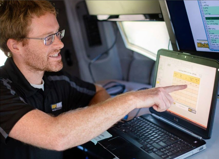 Christopher Morgan shows data collection results from the project vehicles in the Michigan Tech Mobile Lab .