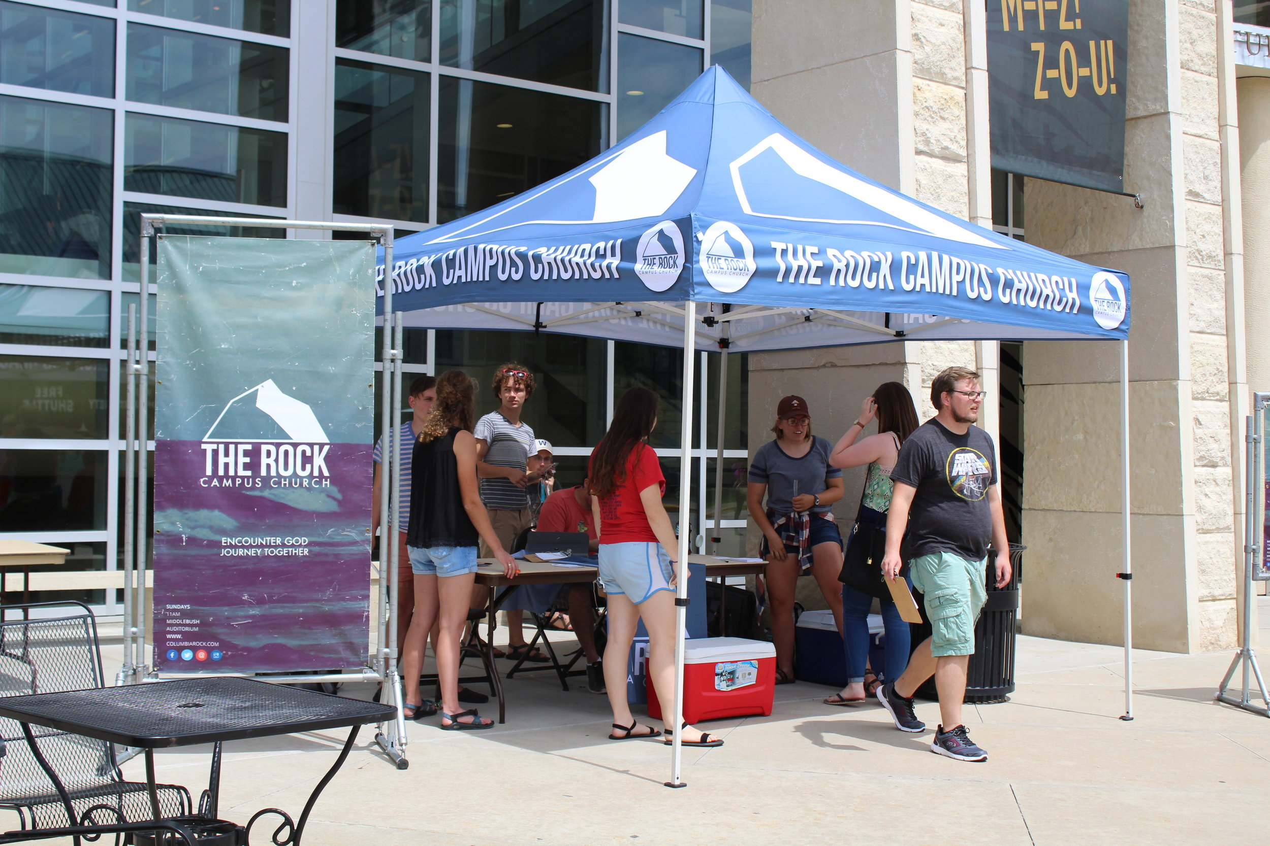 Our students handing out Icee Pops in August
