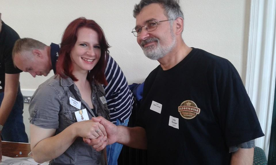 Chrissy receiving a medal at her first megagame, Iron Dice (Photo by Jim Wallman)