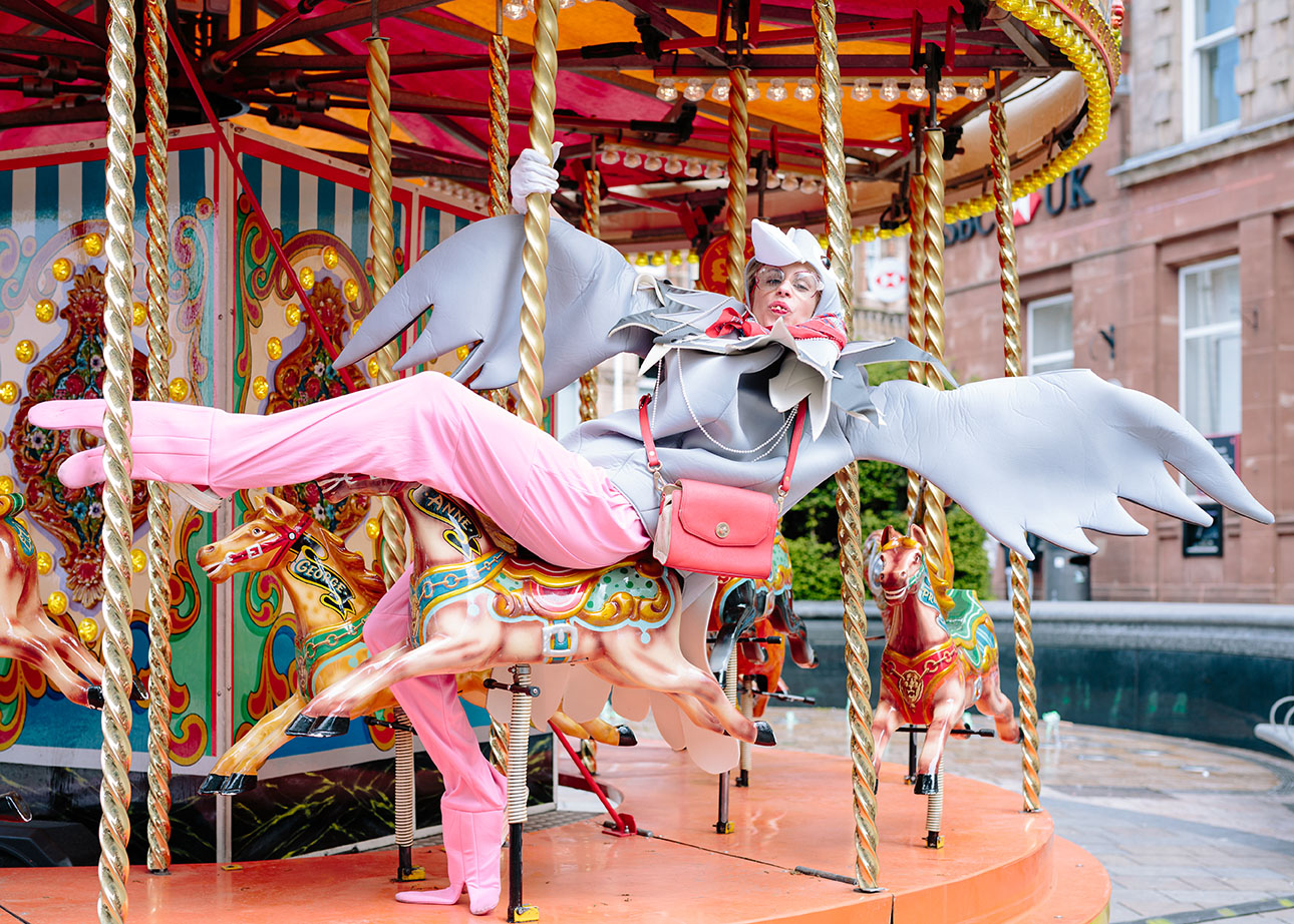 One of the Pigeon Pals, Penny lands on the carousel in Wolverhampton town centre - image by Laura Dicken
