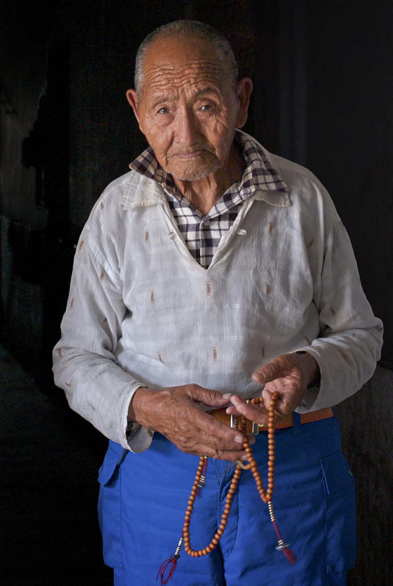 Man with mala beads India.jpg