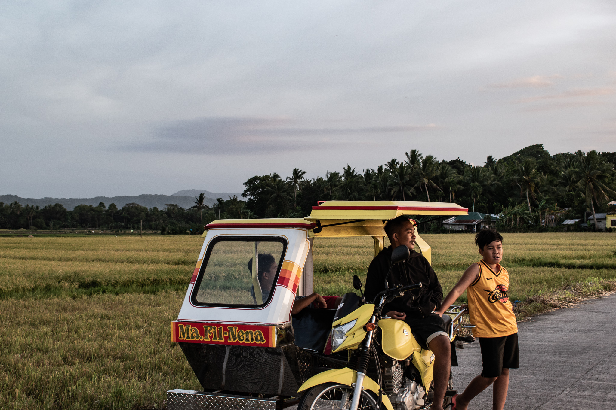 My home town of Ibajay, Philippines, featuring my grandmother's tricycle and my cousins.
