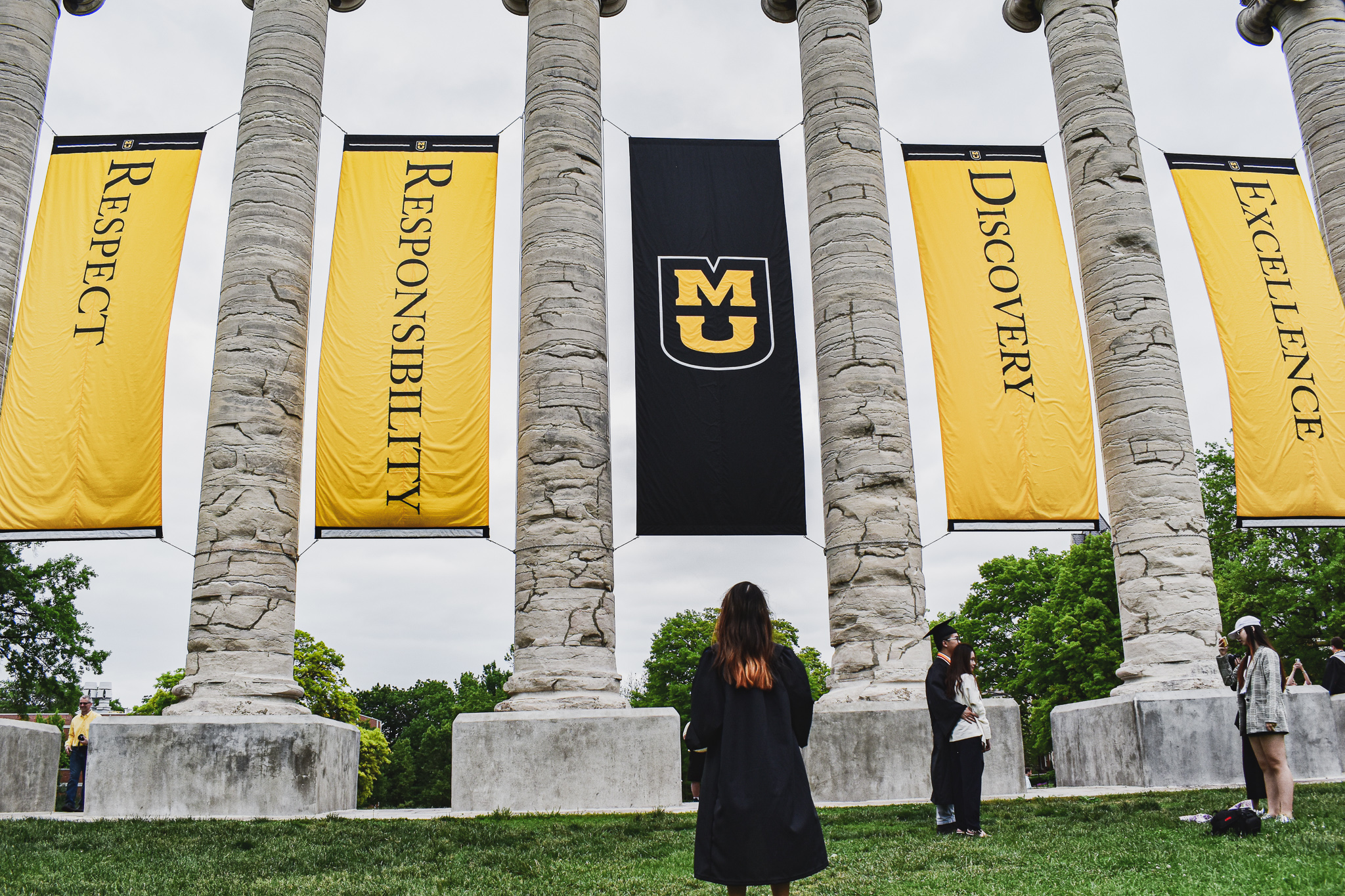 My newly-graduated sister admiring the iconic columns of the University of Missouri, my alma mater where I graduated Magna Cum Laude with degrees in International Business, Management, and Spanish.