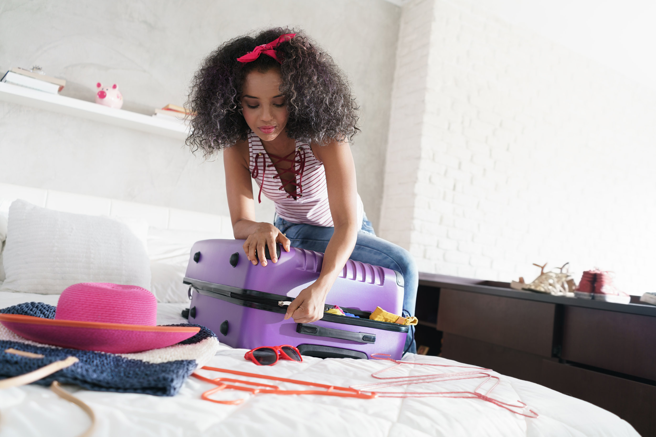 Canva - African American Girl Preparing Baggage for Vacation and Travel.jpg