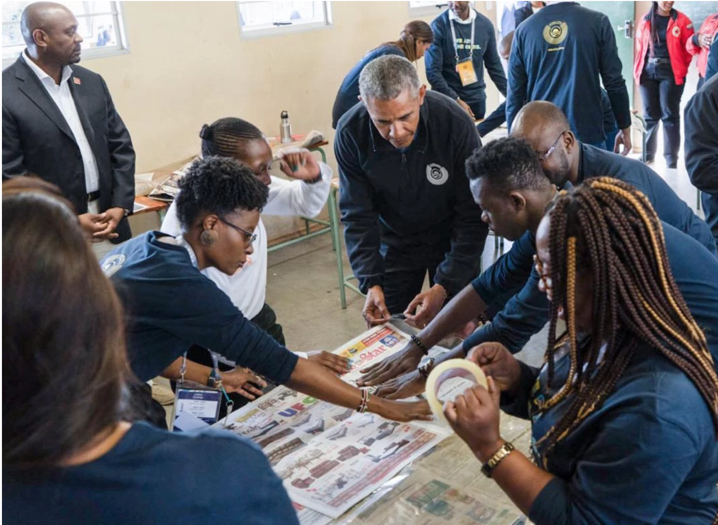 Francisca (bottom right) makes sleeping mats for the homeless with former President Barack Obama during a five-day leadership program in Johannesburg, South Africa.