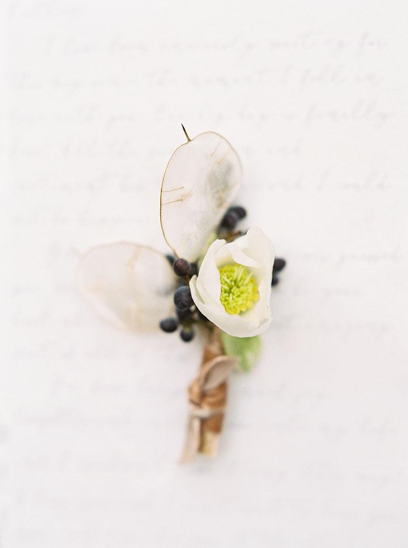 2-portrait-double-pair-lanson-b-jones-floral-and-events-white-boutonniere-hellebore-berries.jpg