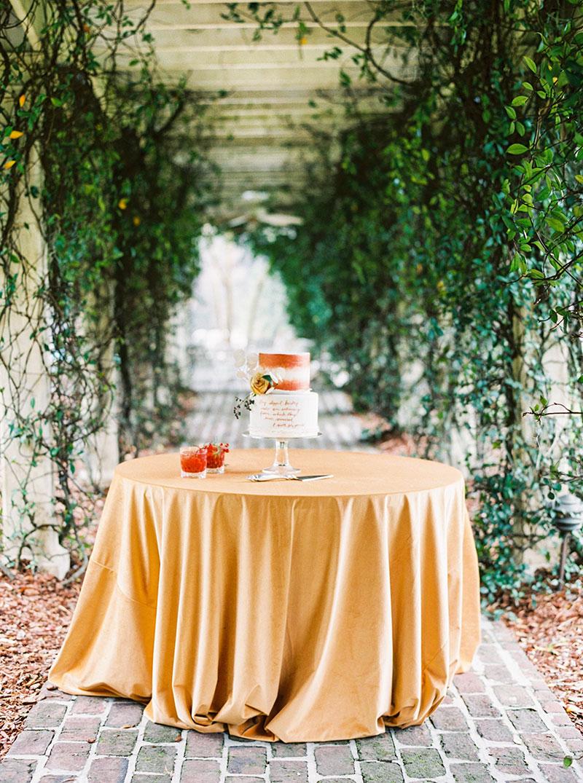 9-portrait-double-pair-1-lanson-b-jones-floral-and-events-houston-event-designer-copper-wedding-cake.jpg