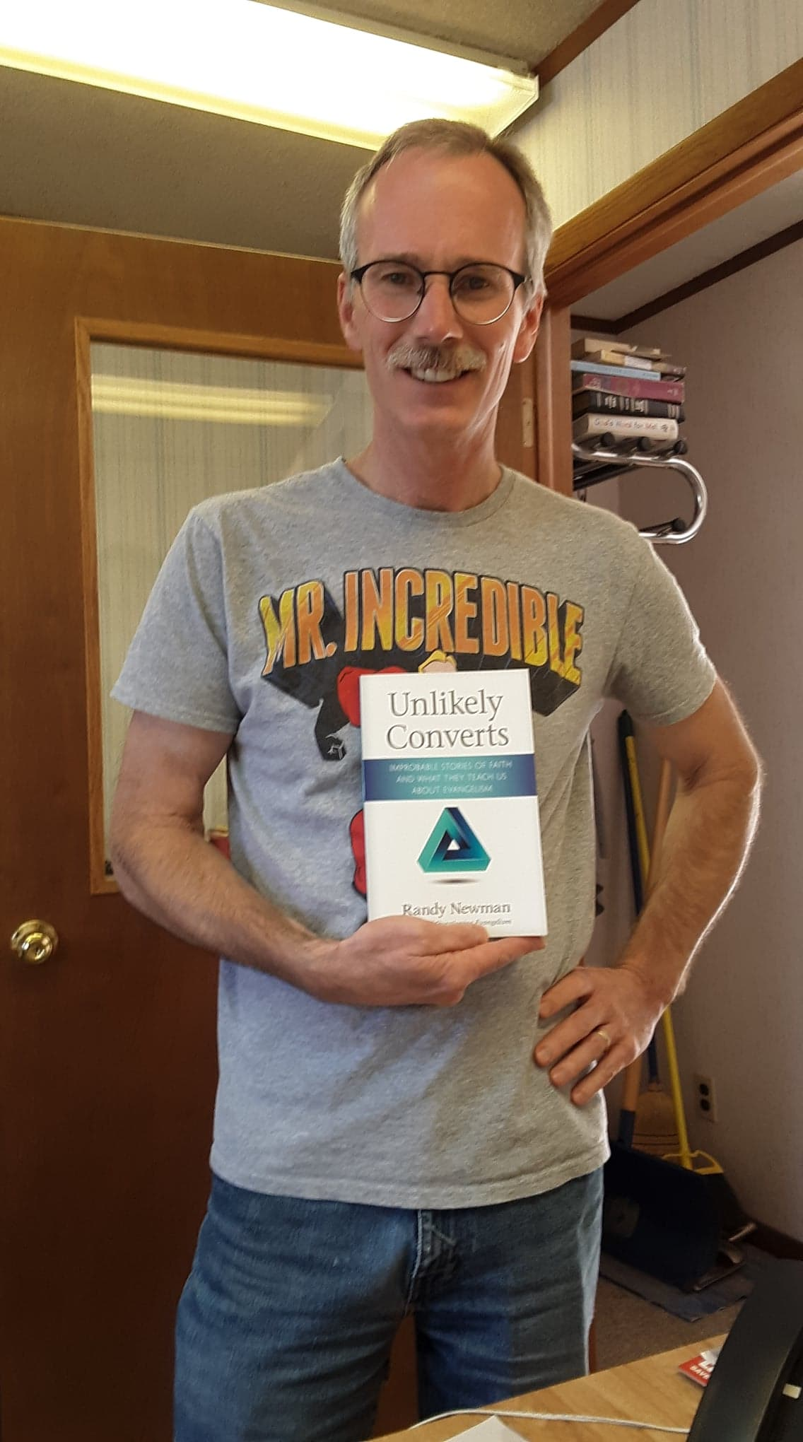Russ shows off Unlikely Converts, authored by today's Coffee Break guest Randy Newman.
