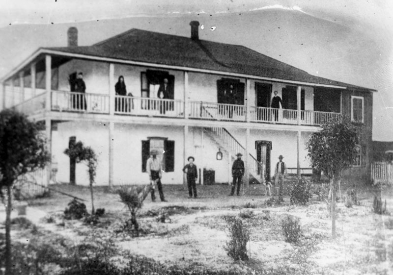 Members of the Lugo Family pose at Bell Gardens adobe, ca. 1892