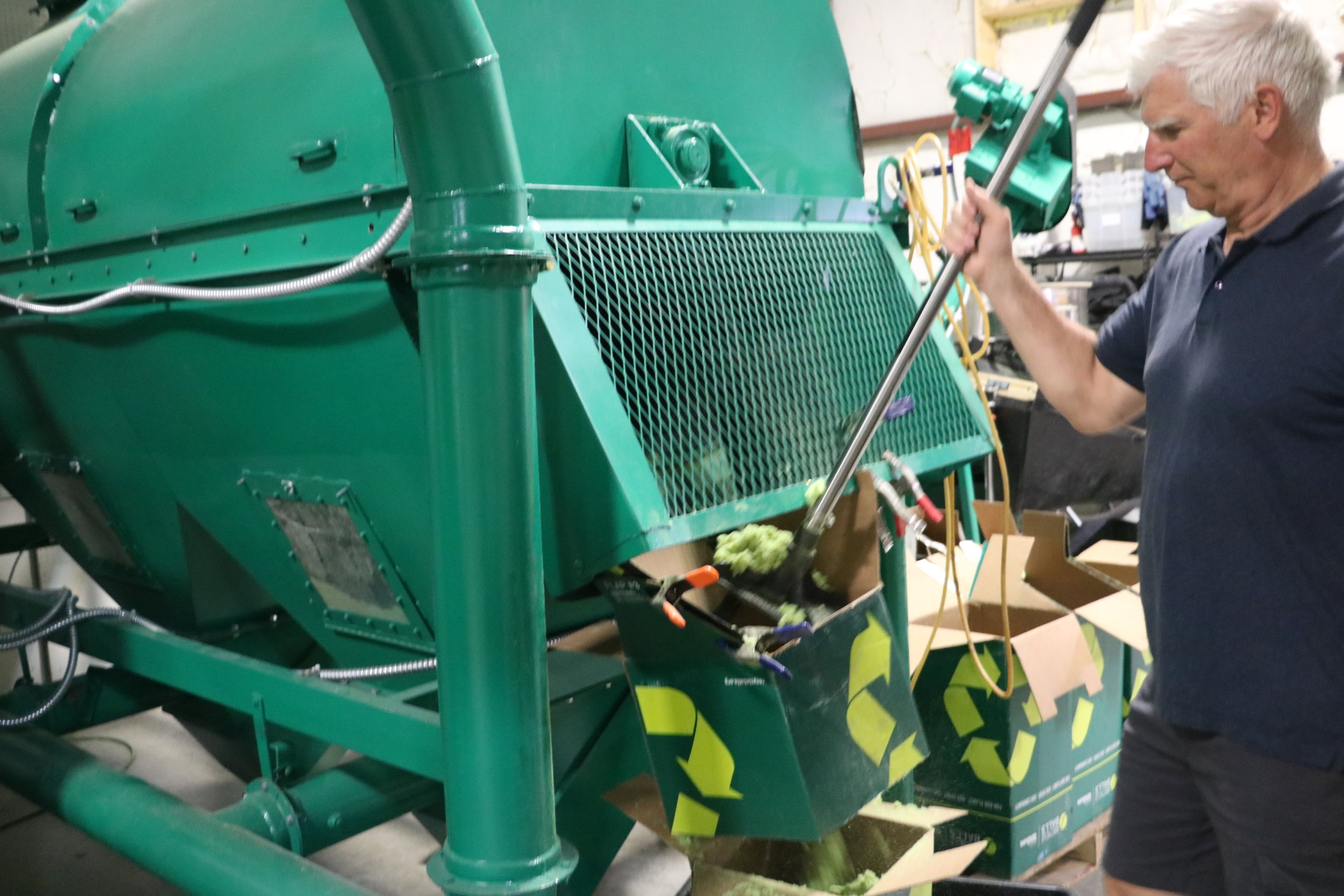"At the end of the deconstruction process, Recycleballs founder Derrick Senior collects tennis-ball fuzz removed by the ""play-it-green"" machine at the South Burlington facility."