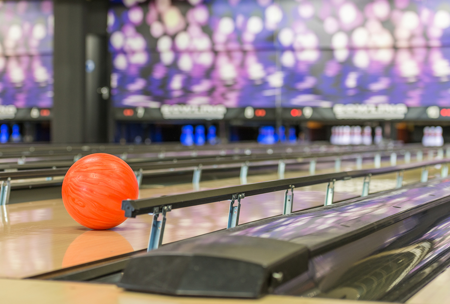 bigstock-bowling-ball-rolls-in-between--230357449.jpg