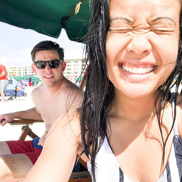 Squinty eye smiles bc I just really love the beach + the sun + my hubby ☀️