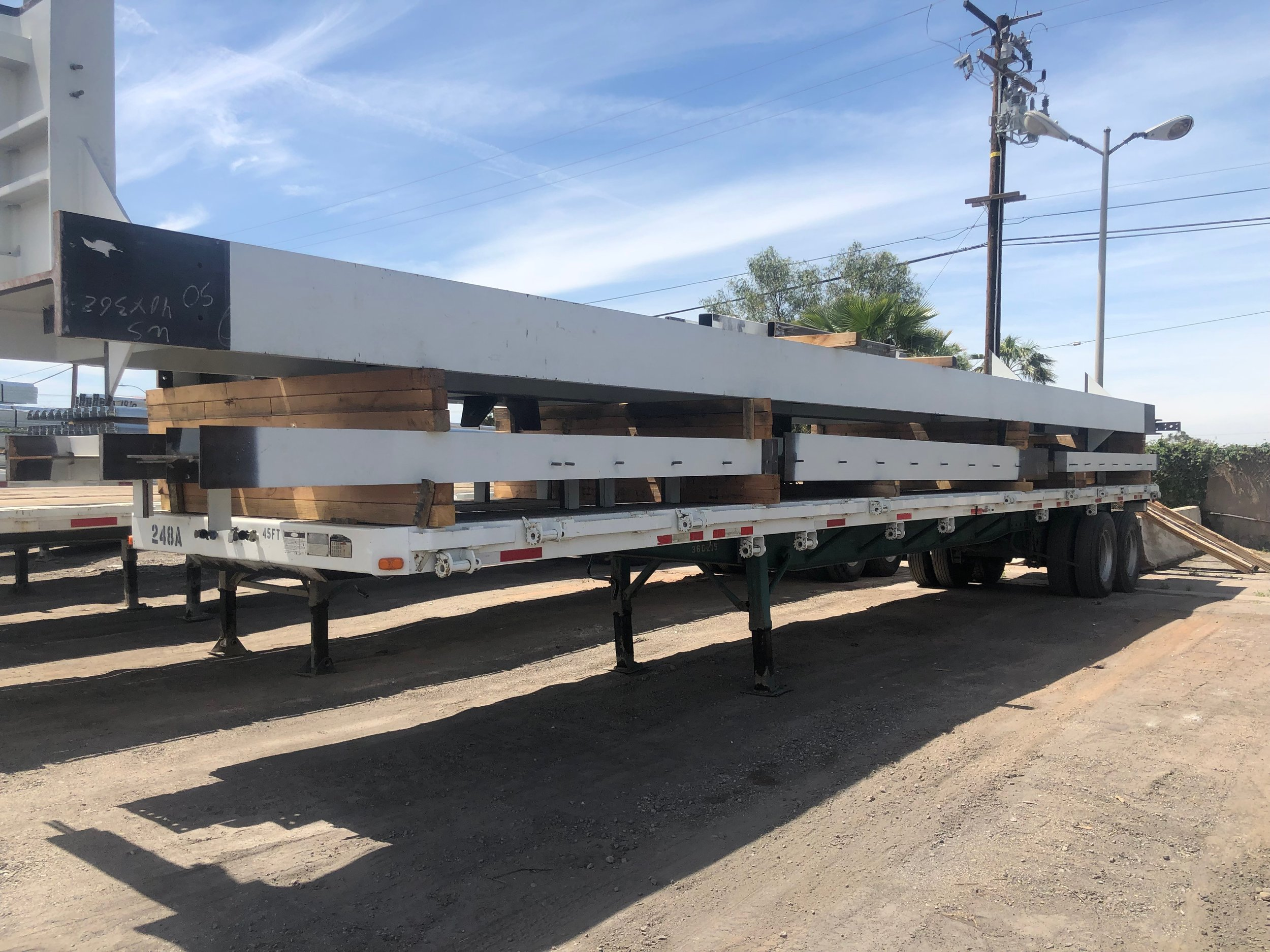 Load of steel awaiting delivery to a job site.