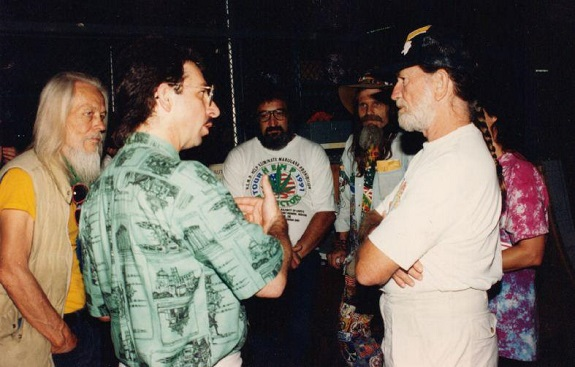 Casper Leitch and Willie Nelson discuss cannabis while  Geroge Clayton Johnson  (left, in yellow shirt) and  Jack Herer  (in back ground wearing the Hemp Learning T-shirt) listen in.