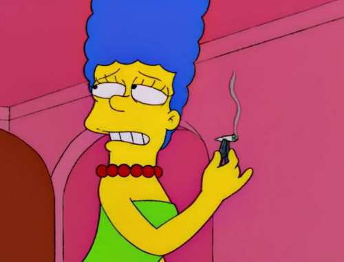 Marge Simpson bogarts a joint.