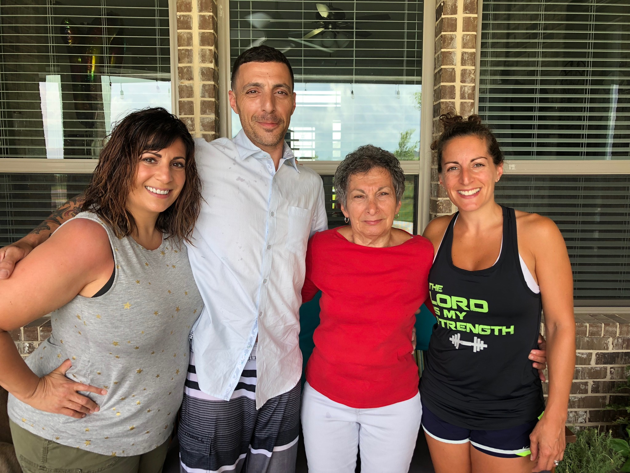Jess with brother Artie, mom Eileen, and sister Rebecca.