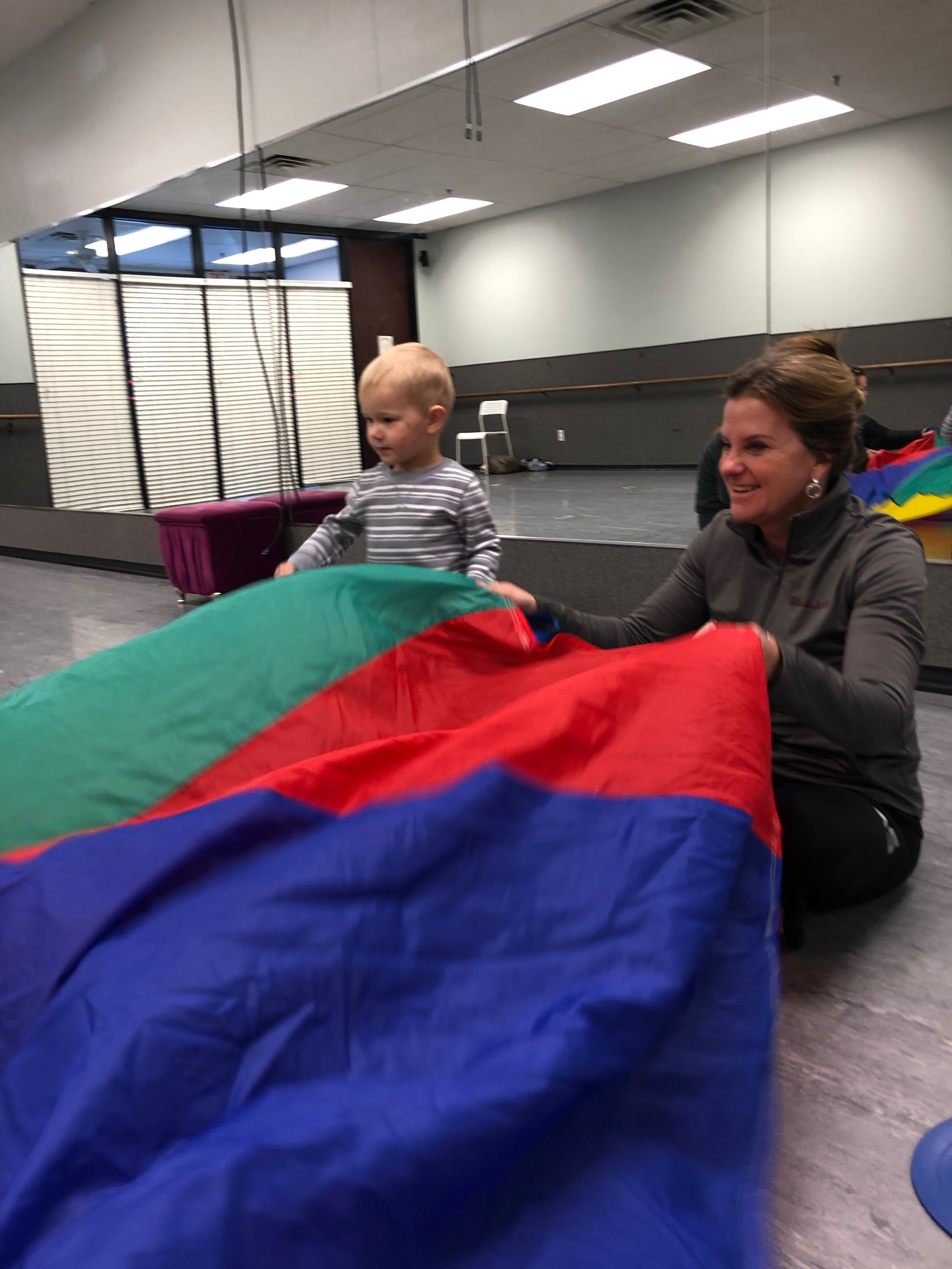 Toddler dance class with parachute