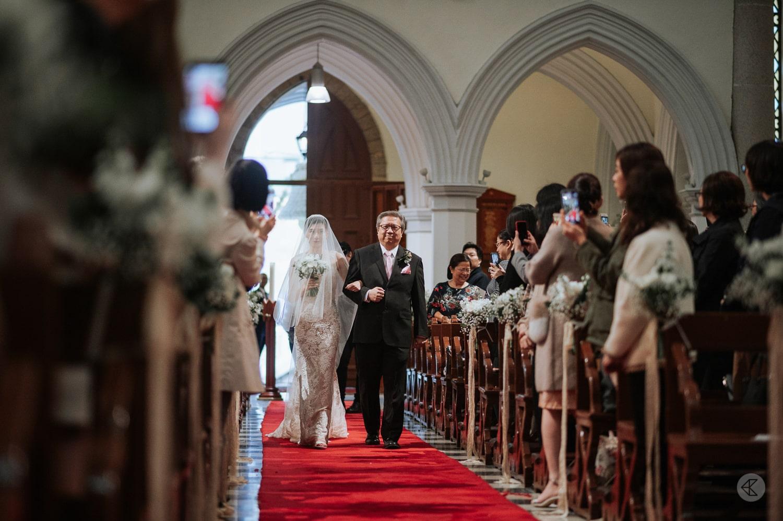 Bride and Dad walk in