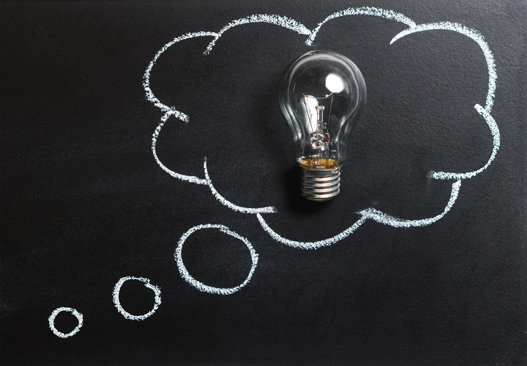 Canva - Clear Light Bulb Placed on Chalkboard.jpg