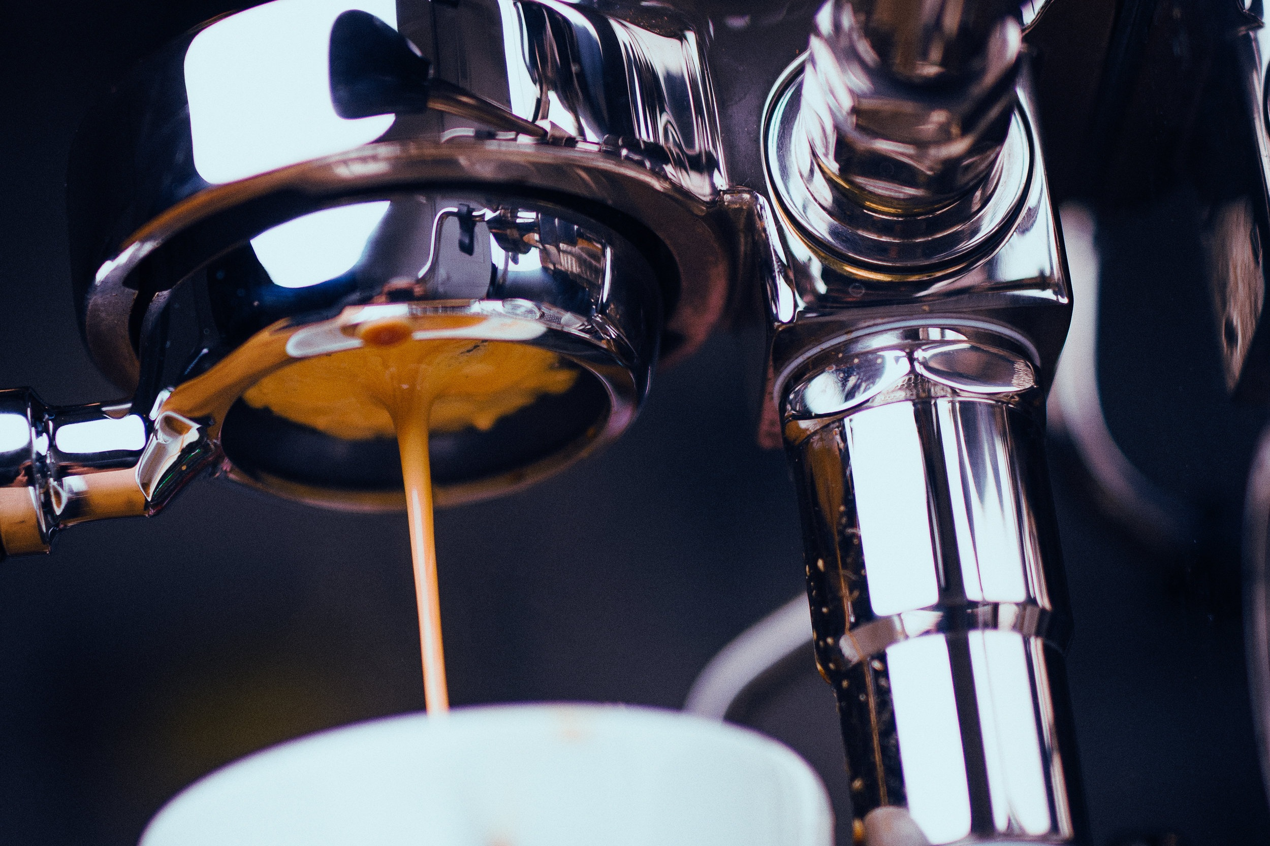 Canva+-+Espresso+Machine+Extracting+Coffee+and+Dripping+in+White+Cup.jpg