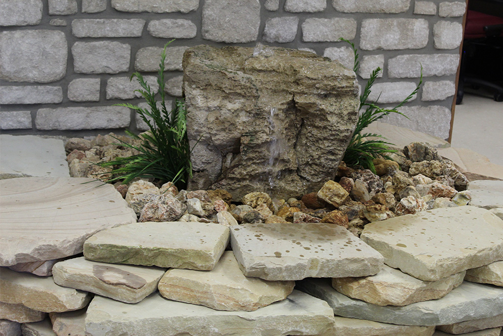 BUBBLING BOULDERS  Create a serene focal point with our Bubbling Boulders. The soothing bubbling sound will make your outdoor space a perfect place to unwind.