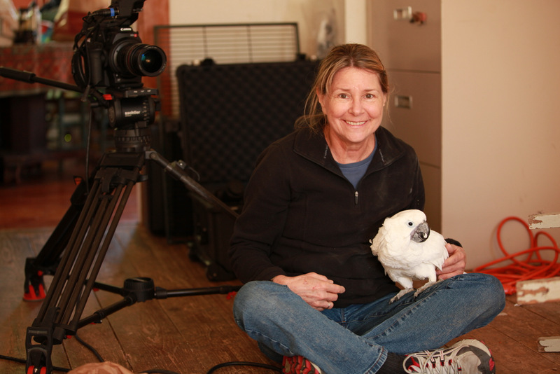 Filmmaker Allison Argo with one of the stars from PARROT CONFIDENTIAL.JPG
