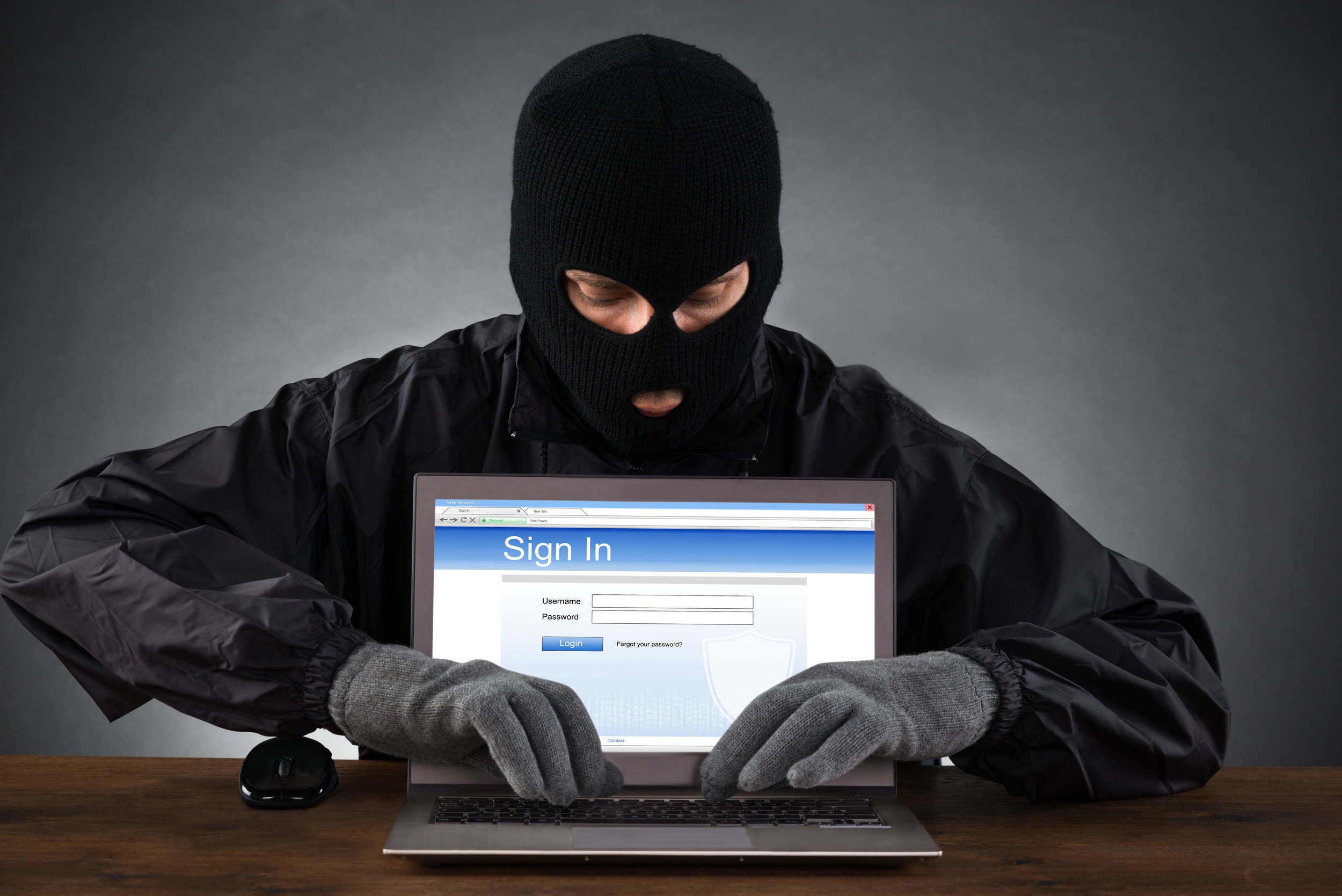 hacker trying to get into laptop