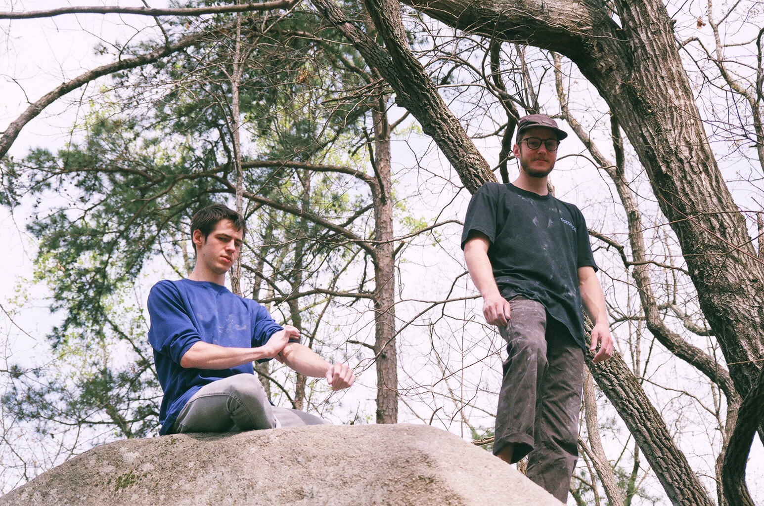 two rock climbers on top of a boulder