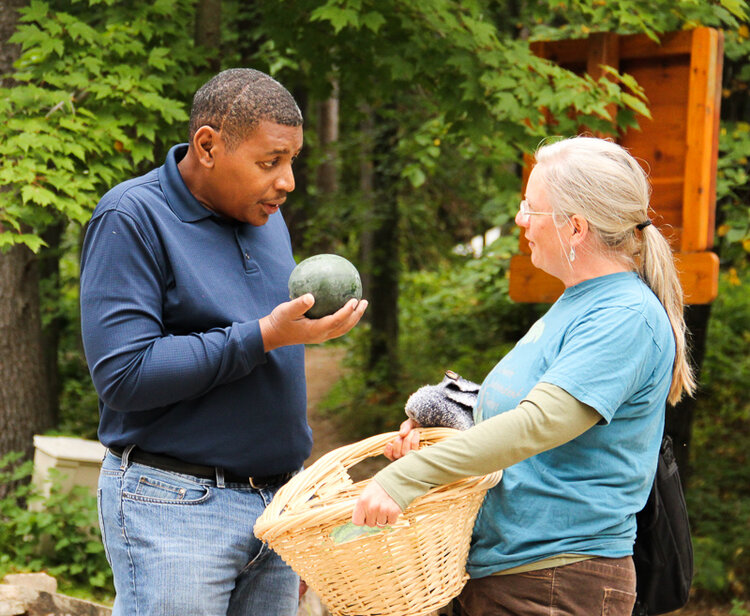 Ms. Brigid of Gravel Road Farm talks with Mr. Stanley about all the great produce they grew!