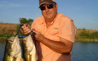 Hard to catch Pure Florida Bass? Guess not! Here's a client with 11 pounds on one bait. A 7 and a 4 pounder.