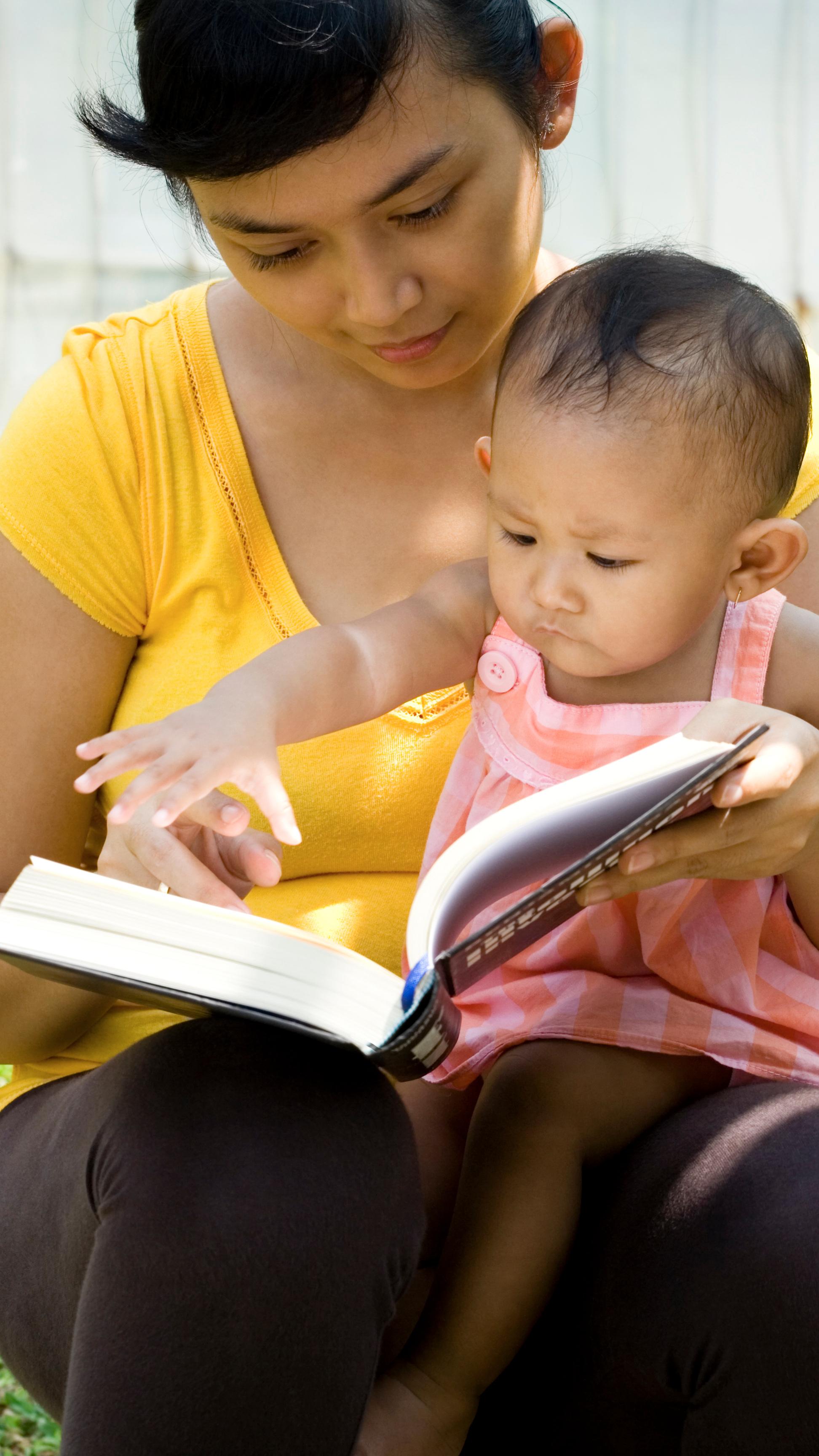 bigstock-Mother-Read-Book-and-Babysit-B-4156573.jpg