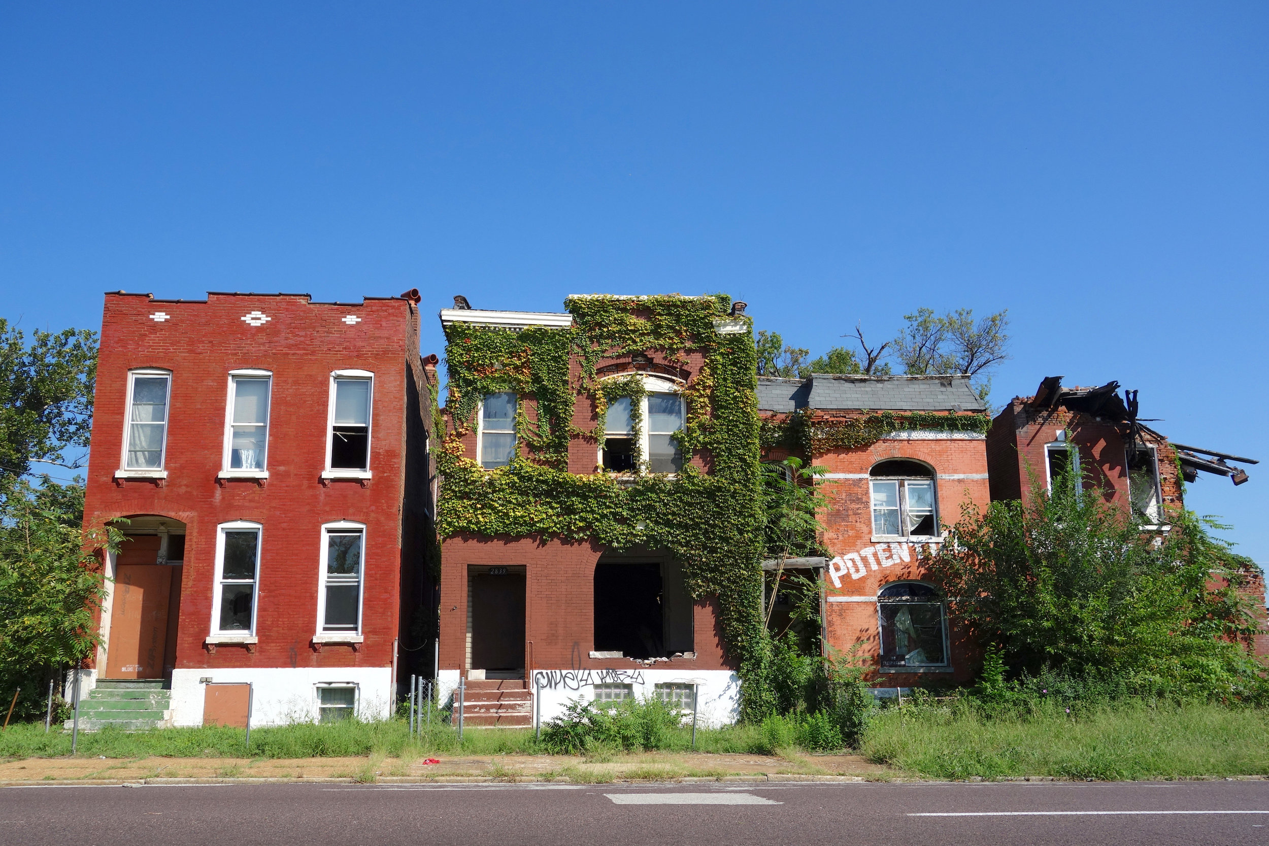 Figure 3. Row of houses in varied states of decay, St. Louis, 2016. Photograph by Joseph Heathcott.