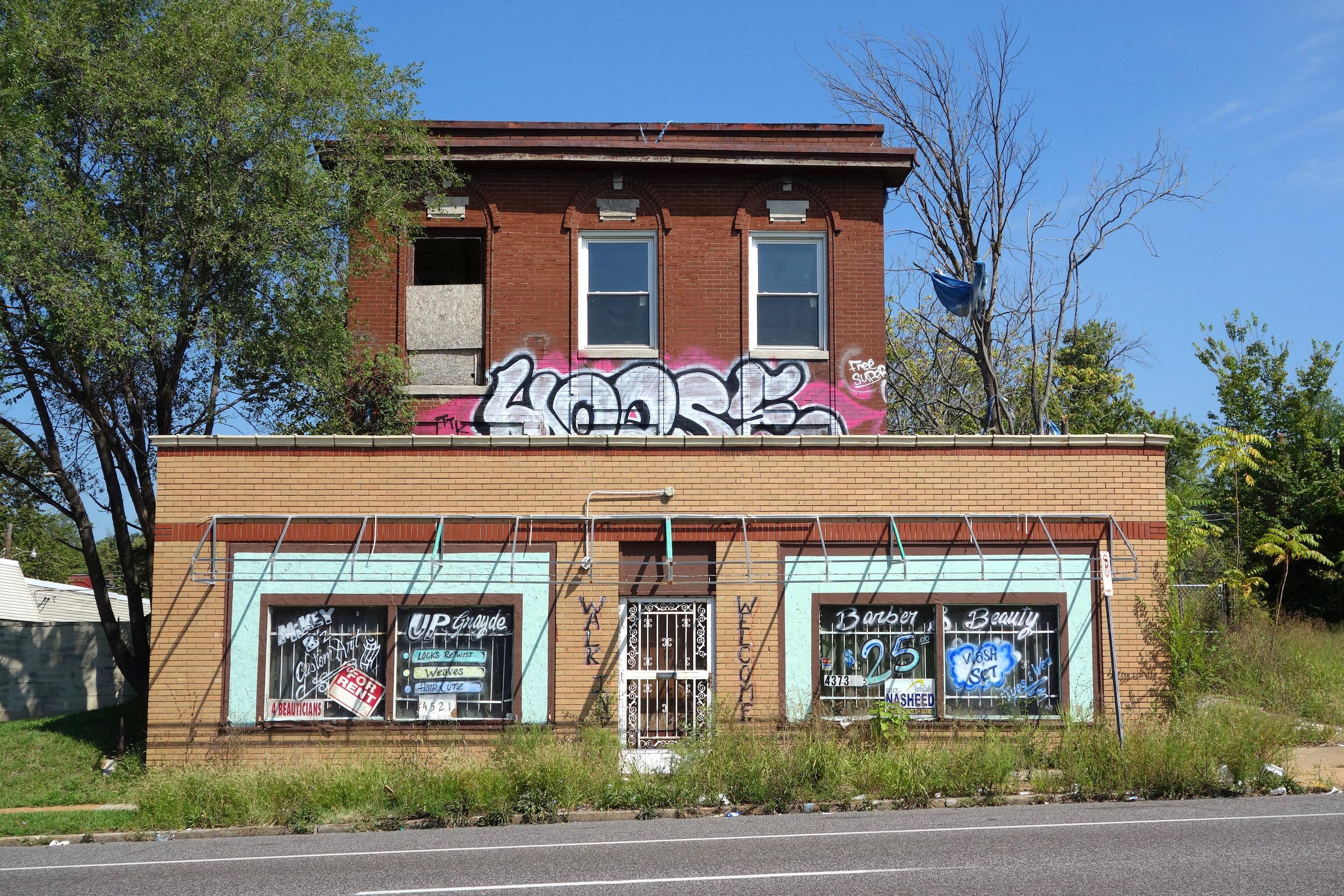 Figure 11. Shop and house, both vacant, Natural Bridge Road, St. Louis, 2016. Photograph by Joseph Heathcott.