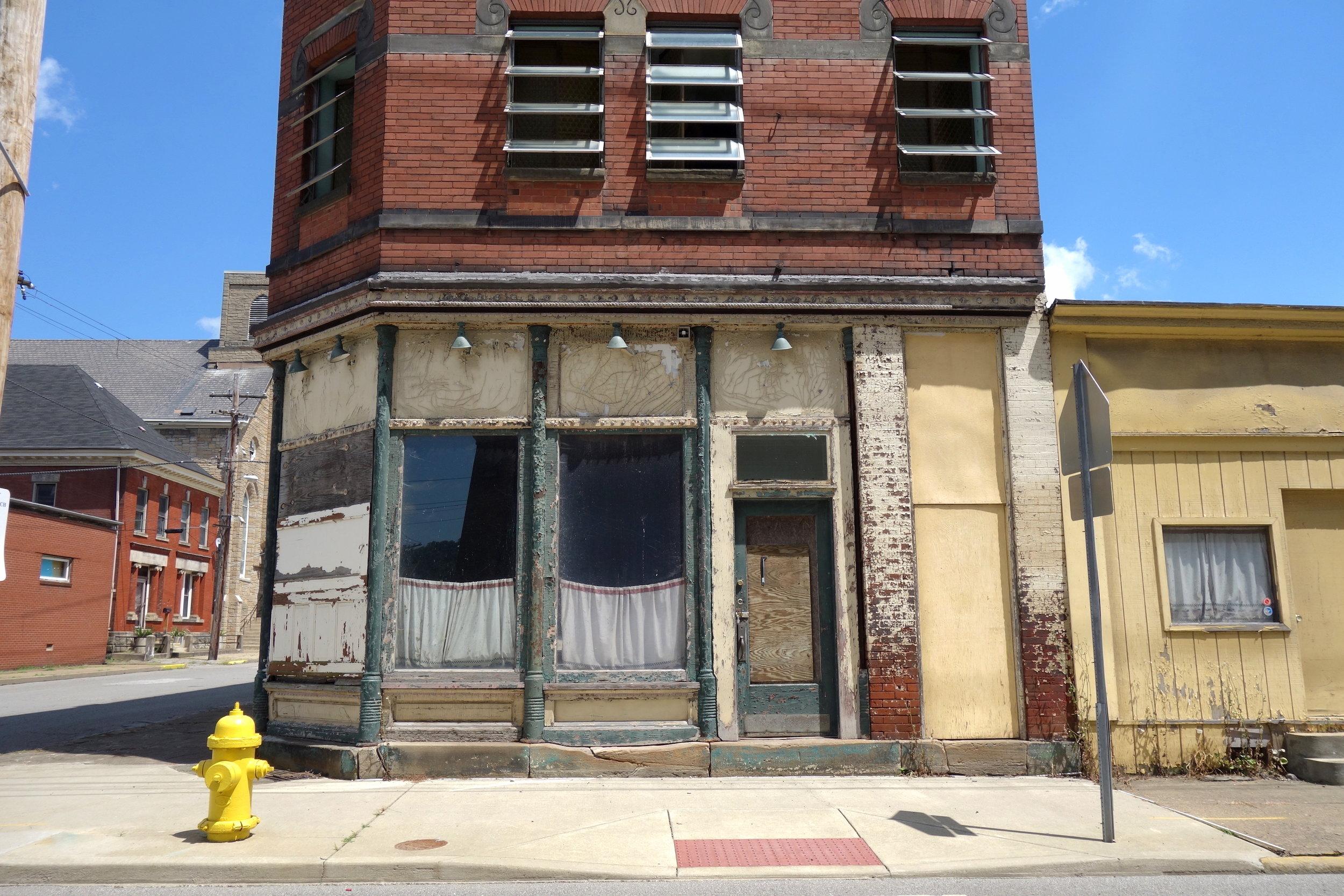 Figure 14. Vacant corner commercial building, Wheeling, 2016. Photograph by Joseph Heathcott.