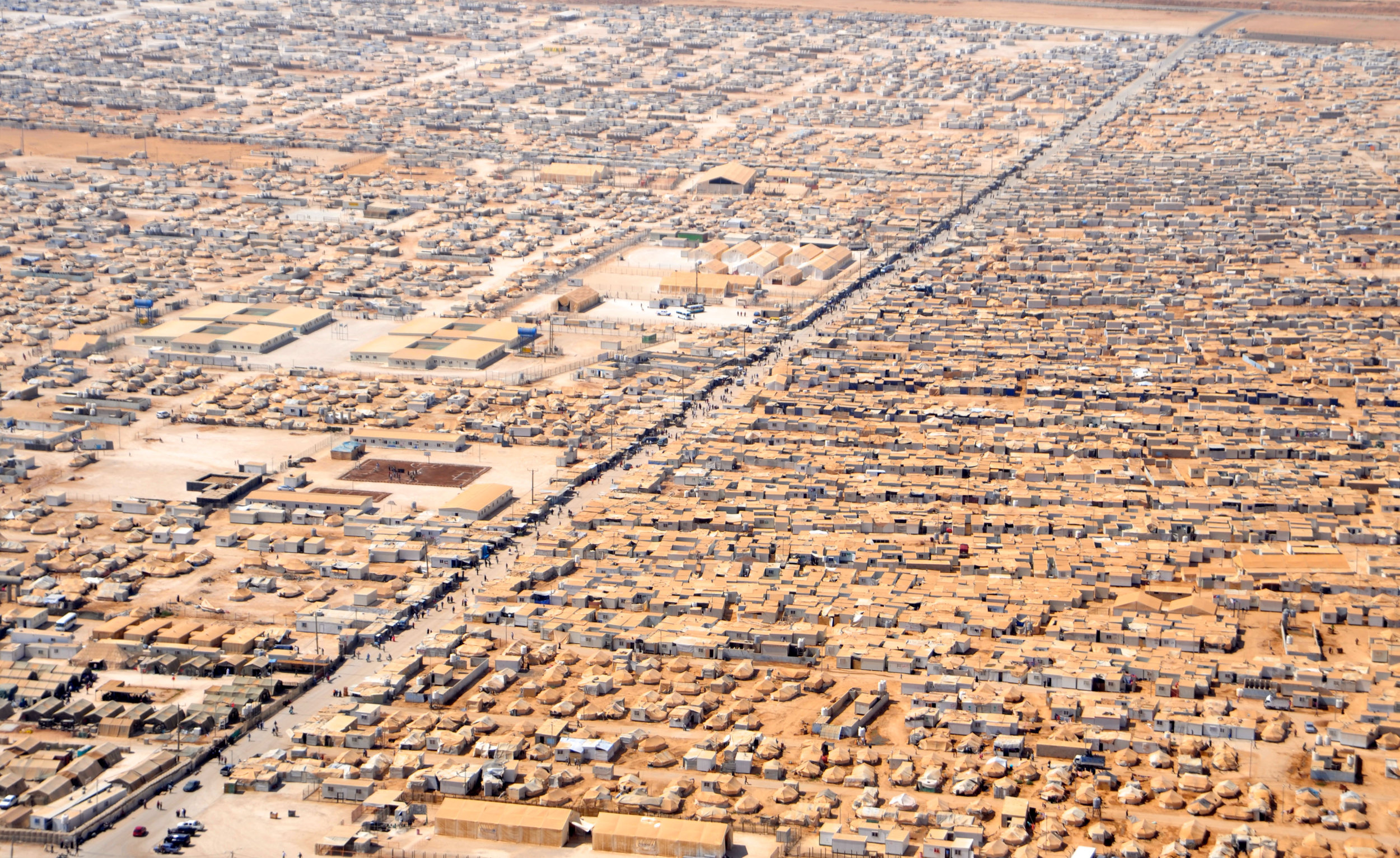 Figure 1. Za'atri camp in Jordan for Syrian refugees as seen on July 18, 2013. The view is from a helicopter carrying U.S. Secretary of State John Kerry and Jordanian Foreign Minister Nasser Judeh. Courtesy U.S. State Department.