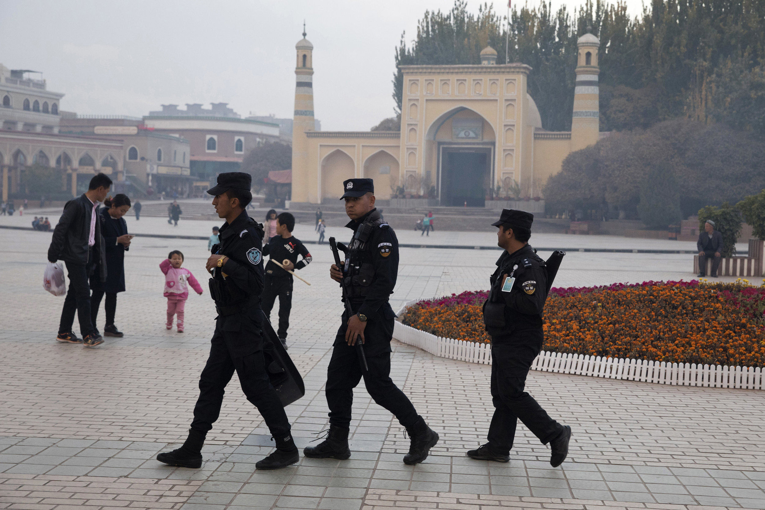 Figure 4. Uighur security personnel patrol near the Id Kah Mosque in Kashgar in western China's Xinjiang region, November 4, 2017. Courtesy Ng Han Guan/AP Images.