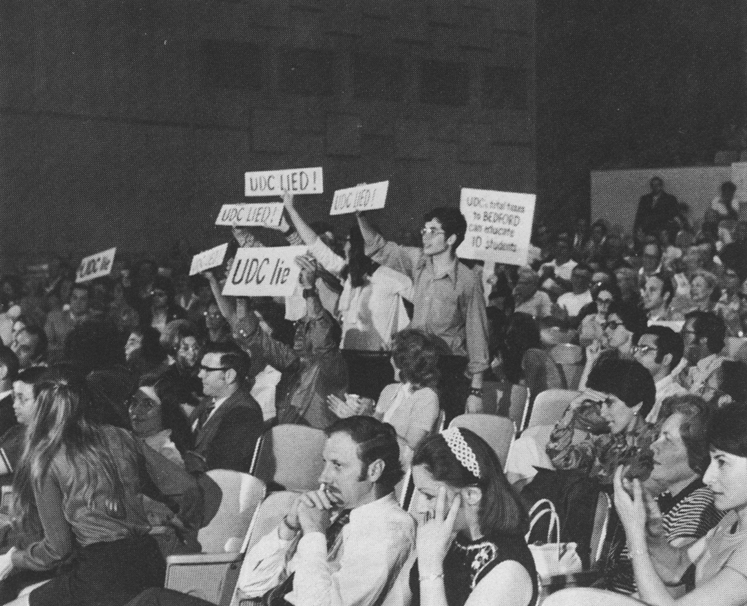 Figure 3. Public hearing in Bedford, New York, on the UDC's Fair Share Housing proposal. The UDC wanted to build one hundred units of garden-apartment-style subsidized housing in each of nine towns in Westchester County. The angry response was typical of the plan's reception. Courtesy New York State Urban Development Corporation, Annual Report of the New York State Urban Development Corporation, 1972.