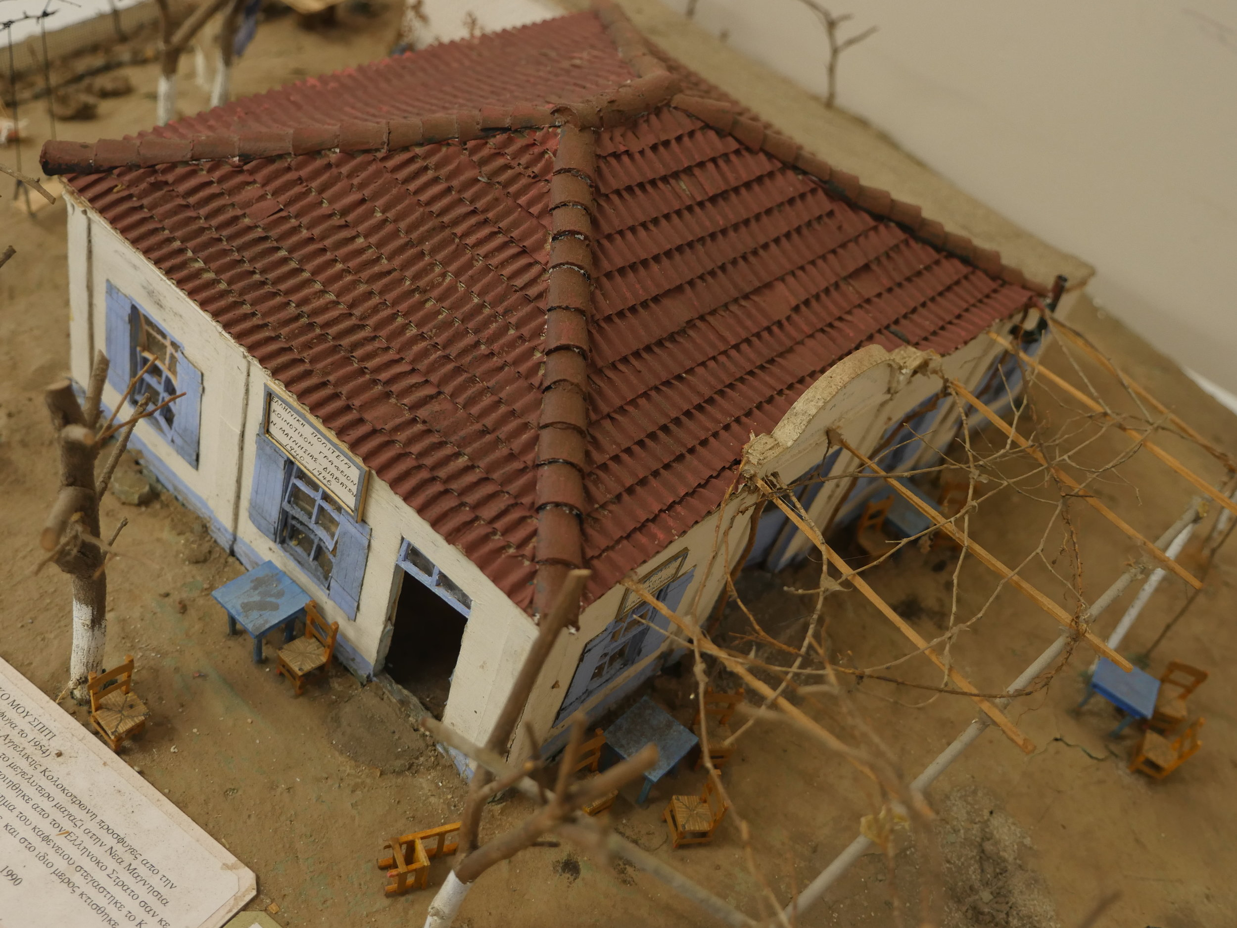 Figure 2. Anastasios Kolokotronis, model of his father's home and café, Nea Magnisia, Thessaloniki. It demonstrates how refugees from the Greek-Turkish population exchange of 1923 adapted government-built refugee housing. The Greek-Australian immigrant -built this model from memory decades later. Photograph by Anoma Pieris, 2016.