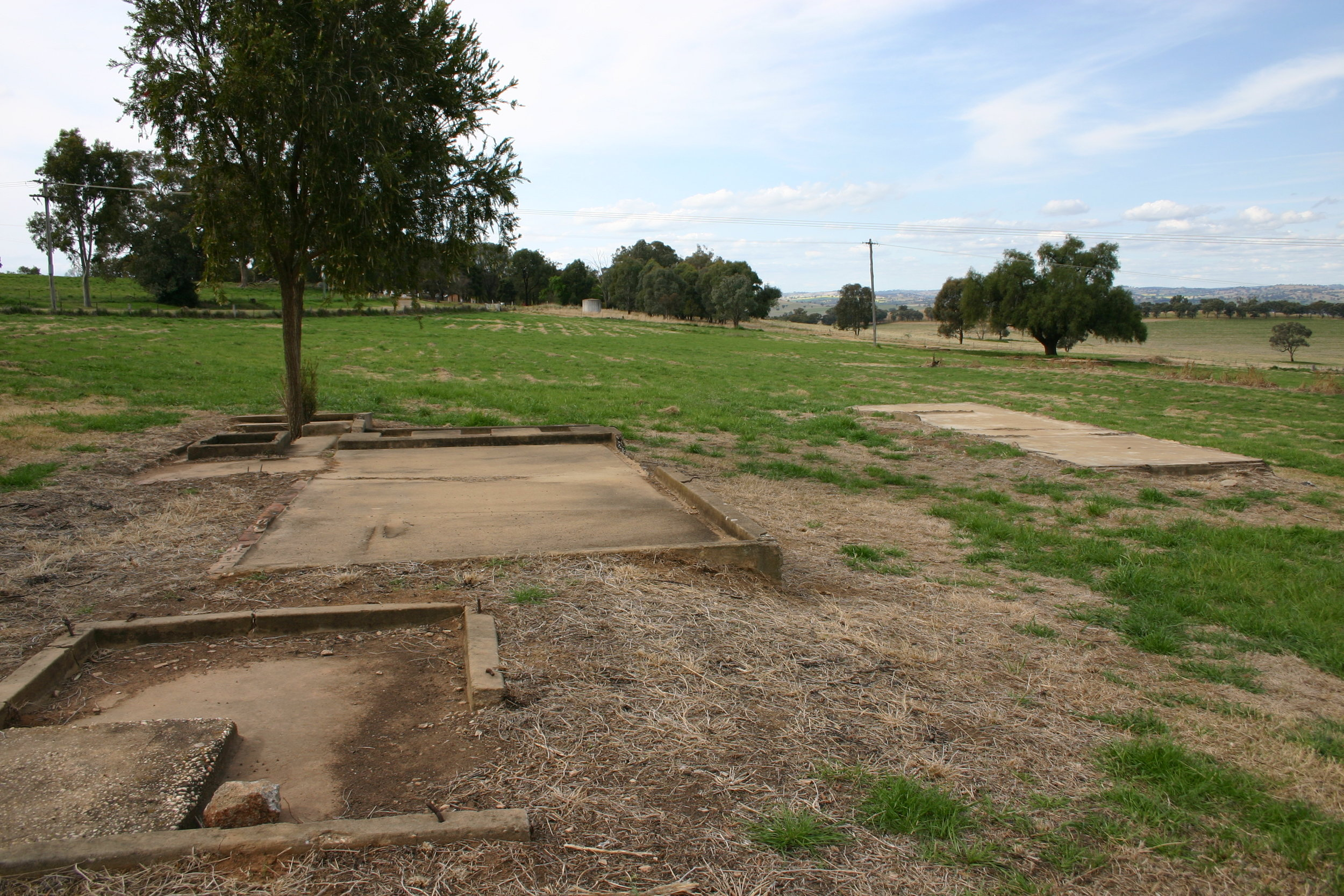 Figure 4. The Cowra Prisoner of War Campsite in Australia. In this place, 231 Japanese POWs were shot dead when staging a mass breakout in August 1944. The campsite has been recovered and landscaped as a heritage site in an effort at conveying this traumatic history. The only physical evidence is the foundations of toilet blocks. Photograph by Anoma Pieris, 2012.
