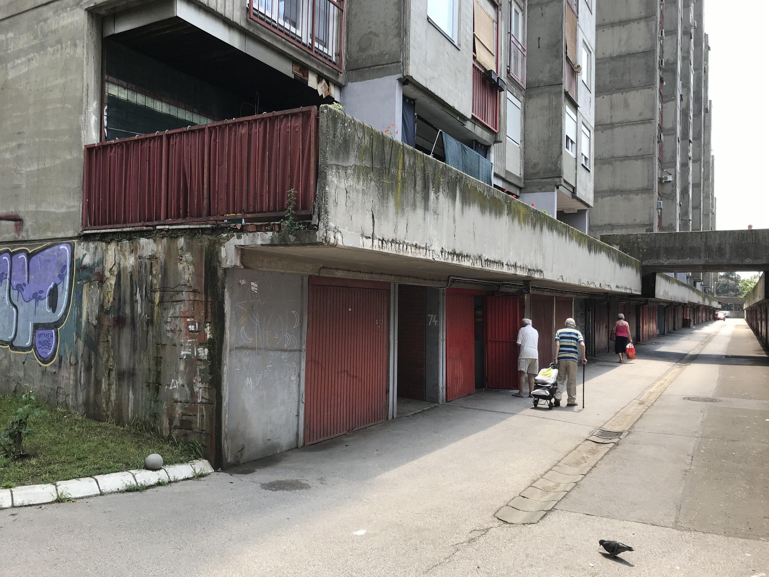 Figure 8. Bežanijski_03: Residents access their basement storage units in Block 63, Bežanijski blokovi, 2019. Photograph by Michael R. Allen.