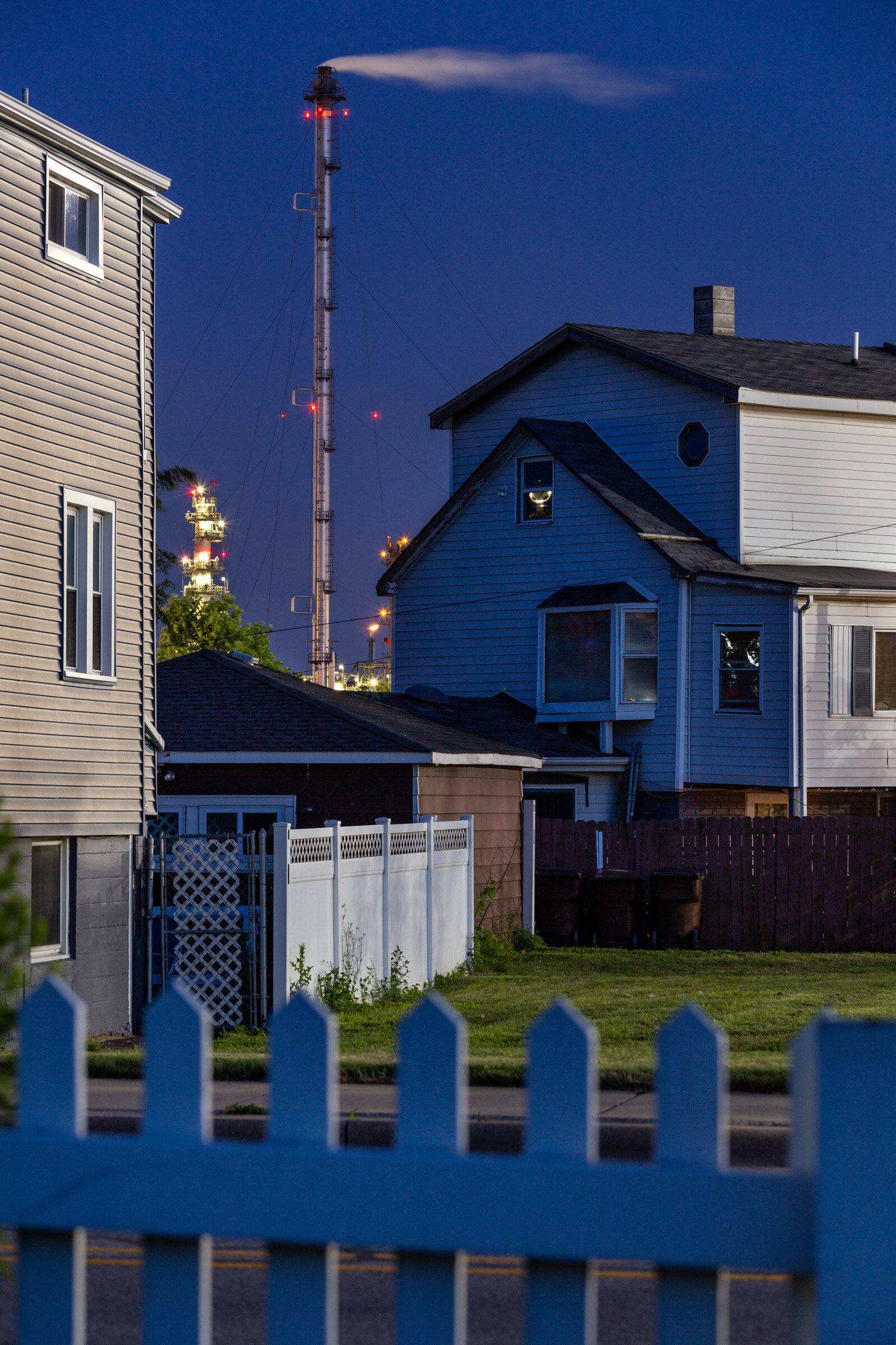 Figure 2. Whiting Houses with Refinery at Dusk, July 2019. Photograph by Matthew Kaplan.