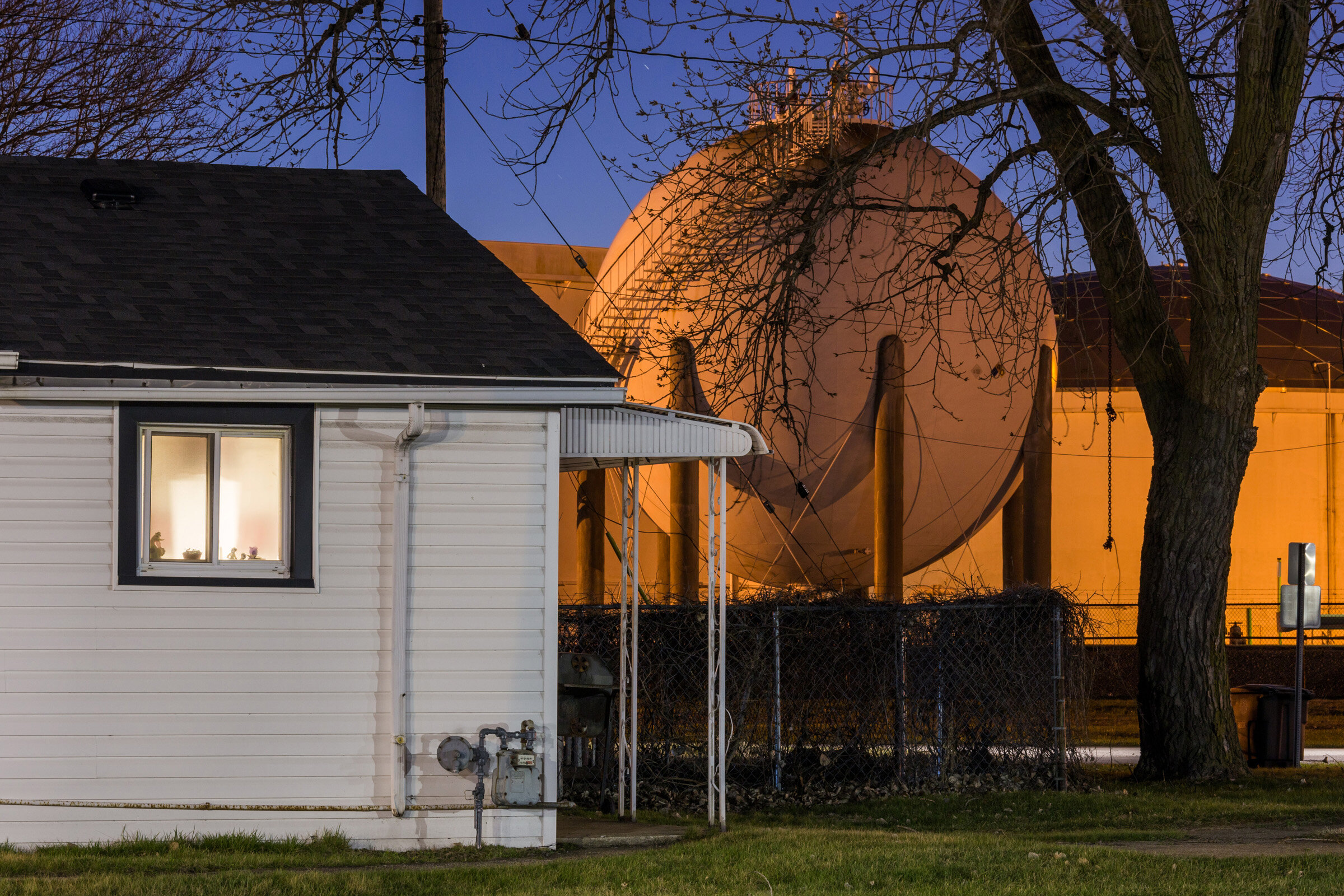 Figure 12. Dusk with House and Tank Farm in East Chicago, Indiana, April 2019. Photograph by Matthew Kaplan.