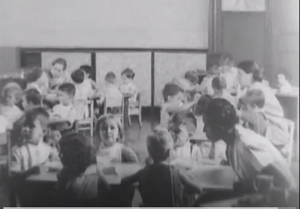 Screenshot 5. An African American caretaker and her young charges.  A Better New York City , 1937, Federal Works Agency, Works Progress Administration, National Archives.