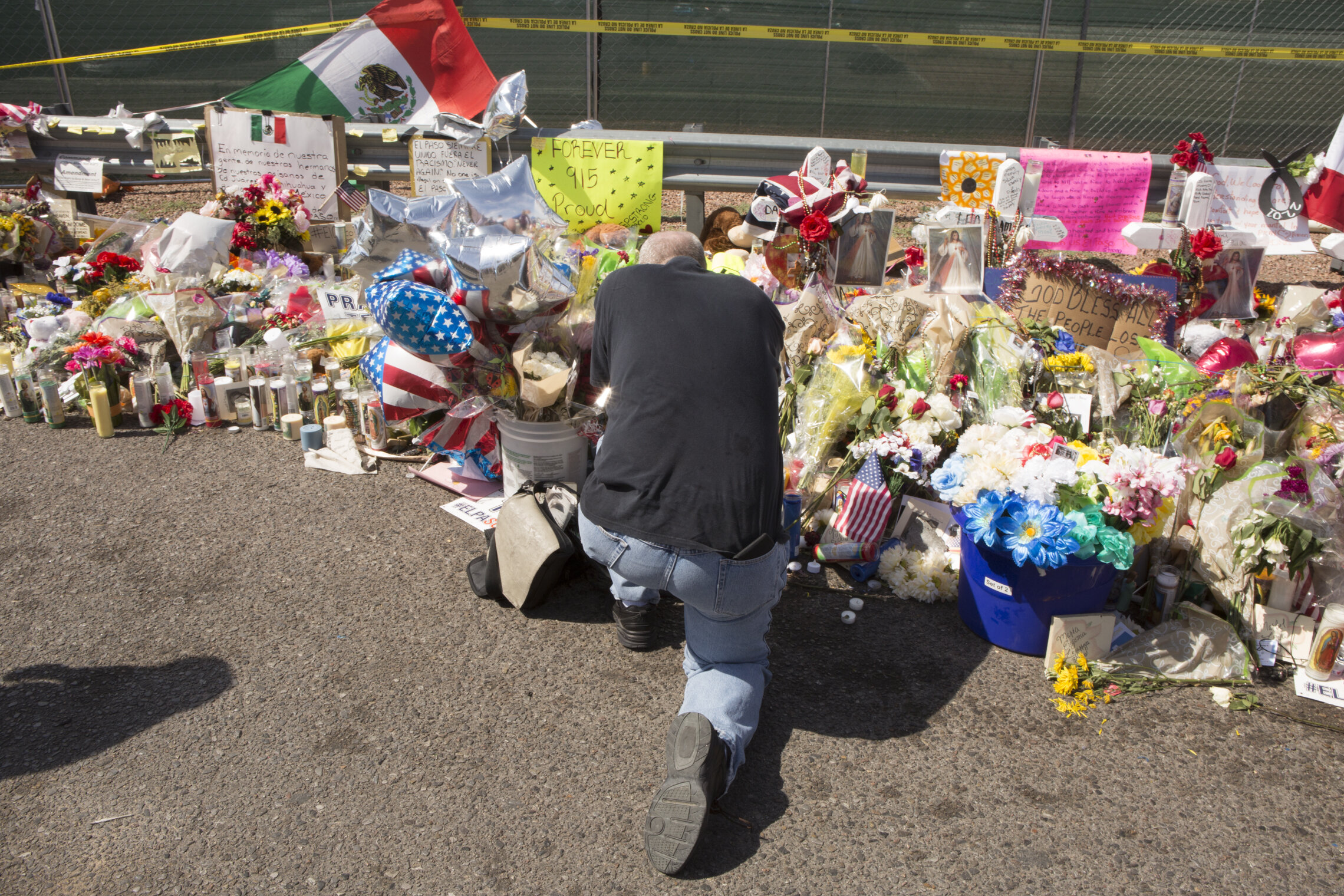 Figure 2: Mourning after the El Paso mass shooting. Photo by Peter Svarzbein.