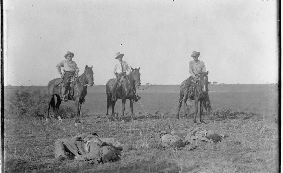 """Figure 4: Texas Rangers pose with Mexicans after a """"bandit raid"""" in 1915. The Robert Runyon Photograph Collection, Courtesy of the Center for American History, The University of Texas at Austin."""