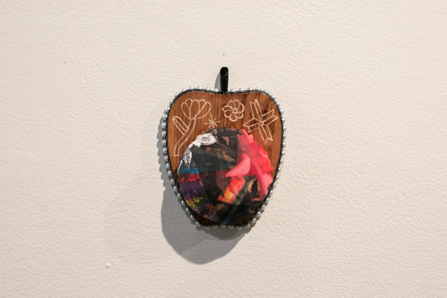 Apple Isle Pincushion, 2019, found wood coaster (engraved), handmade paper collage digitally printed on cotton sateen, plastic pearls, acrylic paint, resin.  Photography by Mel De Ruyter